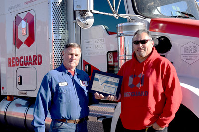 RedGuard drivers Wayne Peterson and Steve Madrigal accept the award for first place in the Flatbed Division, Unlimited Employees Category in the American Trucking Association (ATA) National Industrial Safety Contest.