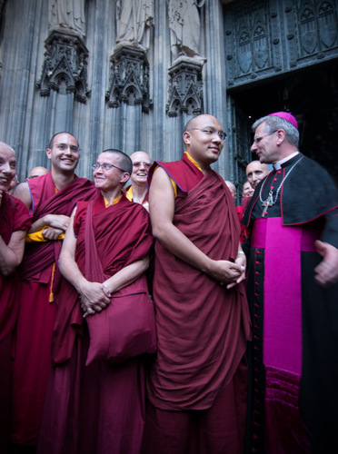 The Karmapa in Cologne, Germany on the steps of the Cologne Cathedral with Tibetan Buddhist monks and Catholic ...