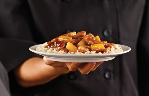 Buffets, Inc. and its portfolio of restaurants including Ryan's, HomeTown Buffet, and Old Country Buffet are now featuring Teriyaki Pineapple Chicken. Available for a limited time at the Mongolian Stir Fry station, guests may enjoy this made-to-order dish that pairs well with the new Strawberry Mandarin Salad.  (PRNewsFoto/Buffets, Inc.)