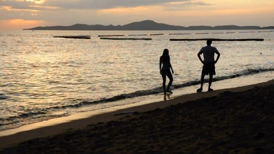 """Artist Kritchanut Onmang submitted the three millionth video clip on Pond5, """"Couple Walking on the Beach in Twilight."""""""