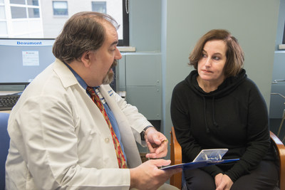 Dr. Matthew Sims talks with his patient, Judy Post.