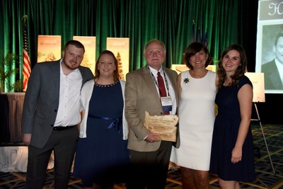 Oregon Bankers Hall of Fame inductee Rick  Roby (center) pictured with (from left) his son Phillip, daughter Jessica, wife Elaine and daughter Lauren.