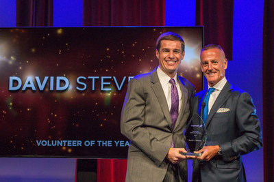 Aramark's Chairman, President and CEO, Eric Foss, presents David Stevens with company's 2016 Volunteer of the Year award, in recognition of his commitment to volunteer service and leadership in his community.