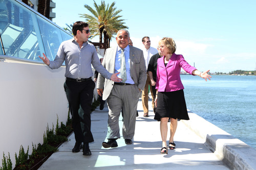 Miami Beach Commissioner Michael Gongora, Miami Beach City Manager Jimmy L. Morales, and Aimco Senior Vice President Patti Shwayder walk along a new,  1/3 mile stretch of the Baywalk constructed by Aimco, and opened to the public at a May 21 ribbon-cutting ceremony.   (PRNewsFoto/Aimco)