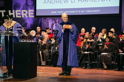 President Andrew Hamilton receives NYU's charter during the the 16th Inauguration celebration at the University from Board Chair William R. Berkley (Left); Copyright (C) NYU Photo Bureau: Slezak