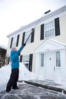 Homeowner using new True Temper Telescoping Roof Rake.  (PRNewsFoto/Ames True Temper)