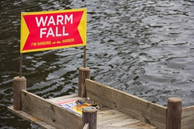 """Baltimore Bill, the Weather-Predicting Crab, moves down the Old Bay plank's """"Warm Fall"""" exit before plunging into the Baltimore Inner Harbor. (PRNewsFoto/McCormick & Company, Inc.)"""