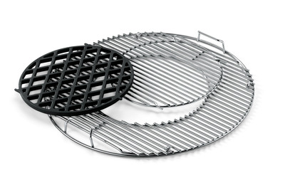 A new accessory for charcoal grillers, the integrated Weber Original Gourmet Barbecue System is comprised of three cast-iron cookware pieces that fit into a customized hinged cooking grate.    (PRNewsFoto/Weber-Stephen Products LLC)