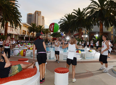 To celebrate POM Wonderful's launch of three new 100% Juice Blends, 125 people set the Guinness World Record for the longest beach-ball bounce in history, which was led by Cheryl Burke and Karina Smirnoff at the Encore Beach Club at Wynn Las Vegas on August 29, 2013 in Las Vegas.  (PRNewsFoto/POM Wonderful)