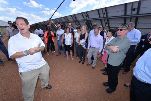 Yosef Abramowitz says that 100% of the day-time energy needs of Israel, the Palestinians, and Africa can be powered by the sun. Here sharing a light moment in Rwanda with U2's Bono, at East Africa's first commercial scale solar field. (PRNewsFoto/Energiya Global Capital)