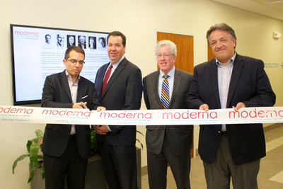 Moderna Therapeutics, the pioneer in developing messenger RNA Therapeutics(TM), expanded its headquarters, including laboratories, Moderna Venture Incubator and manufacturing, on June 11, 2014 to 320 Bent St. in Cambridge, Mass. Pictured from left to right: Stephane Bancel, President and founding CEO, Moderna Therapeutics; Angus McQuilken, Vice President, Massachusetts Life Sciences Center; John Hallinan, Chief Business Officer, MassBio; Noubar Afeyan, Co-founder and Chairman, Moderna Therapeutics, Managing Partner and CEO, Flagship Ventures. (PRNewsFoto/Moderna Therapeutics)