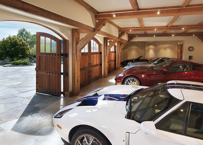Entertain and Preserve with Immaculate Carriage House:  Automobile aficionados will rejoice inside this 1,600 sq ft five-car garage complete with adjacent car wash and compressed air station. The upper floor-a stunning 1500 sq ft banquet hall-features vaulted, open-beam ceilings.  A catering area with full kitchen includes copper cabinets and stainless steel countertops. The Carriage House is constructed using wood beams reclaimed from a century old bridge on Utah's The Great Salt Lake. A vast courtyard with koi pond and cascading waterfall separates the main home from the carriage house.
