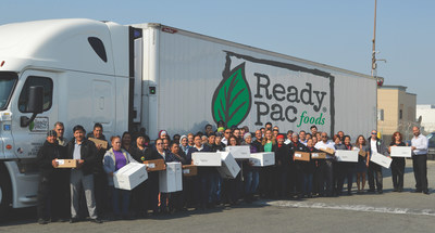 Ready Pac Foods Associates loading 30,000 salads onto truck bound for Baton Rouge, La. Flood victims.