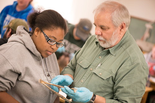 Unity College Professor George Matula works with a student in the classroom.  (PRNewsFoto/Unity College)