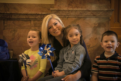 Miss Colorado Kelly Johnson joins Gov. Hickenlooper and children from a Denver area child care center to kick off Child Abuse Prevention Month