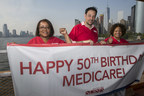 The New York State Nurses Association celebrates Medicare's 50th birthday on the Staten Island Ferry.