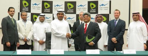 Khalifa Al Shamsi, Dilip Rahulan and other officials of Etisalat Group and Pacific Controls at the signing ...
