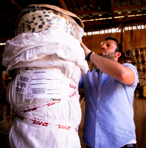 Filmmaker and Panthera partner, Greg Lomas, unpacks the faux leopard fur delivery -- each roll approximating 50m of fabric. (PRNewsFoto/DHL) (PRNewsFoto/DHL)