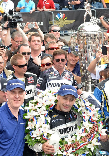 Tony Kanaan celebrated his victory at the 2013 Indianapolis 500 beside the Borg-Warner Trophy(TM) in Victory Lane. The trophy and Kanaan will join BorgWarner in booth 21637 at the 2013 SEMA Show in Las Vegas.  (PRNewsFoto/BorgWarner Inc.)