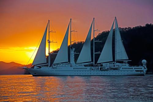 Wind Star enjoys a sunset cruise through the British Virgin Islands.  (PRNewsFoto/Windstar Cruises)