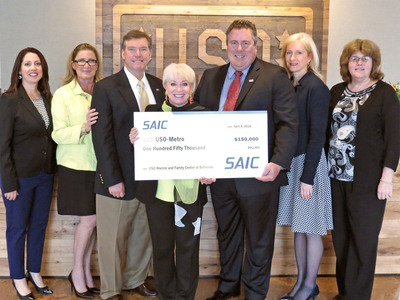 SAIC's Doug Wagoner, Jennifer Smith, Joe Johnson, and Robyn Harvey present USO-Metro President/CEO Elaine Rogers and USO-Metro staff members Annabella Riccio and Pamela Horton with a $150,000 donation in support of the Warrior and Family Center at Bethesda.  (PRNewsFoto/SAIC)
