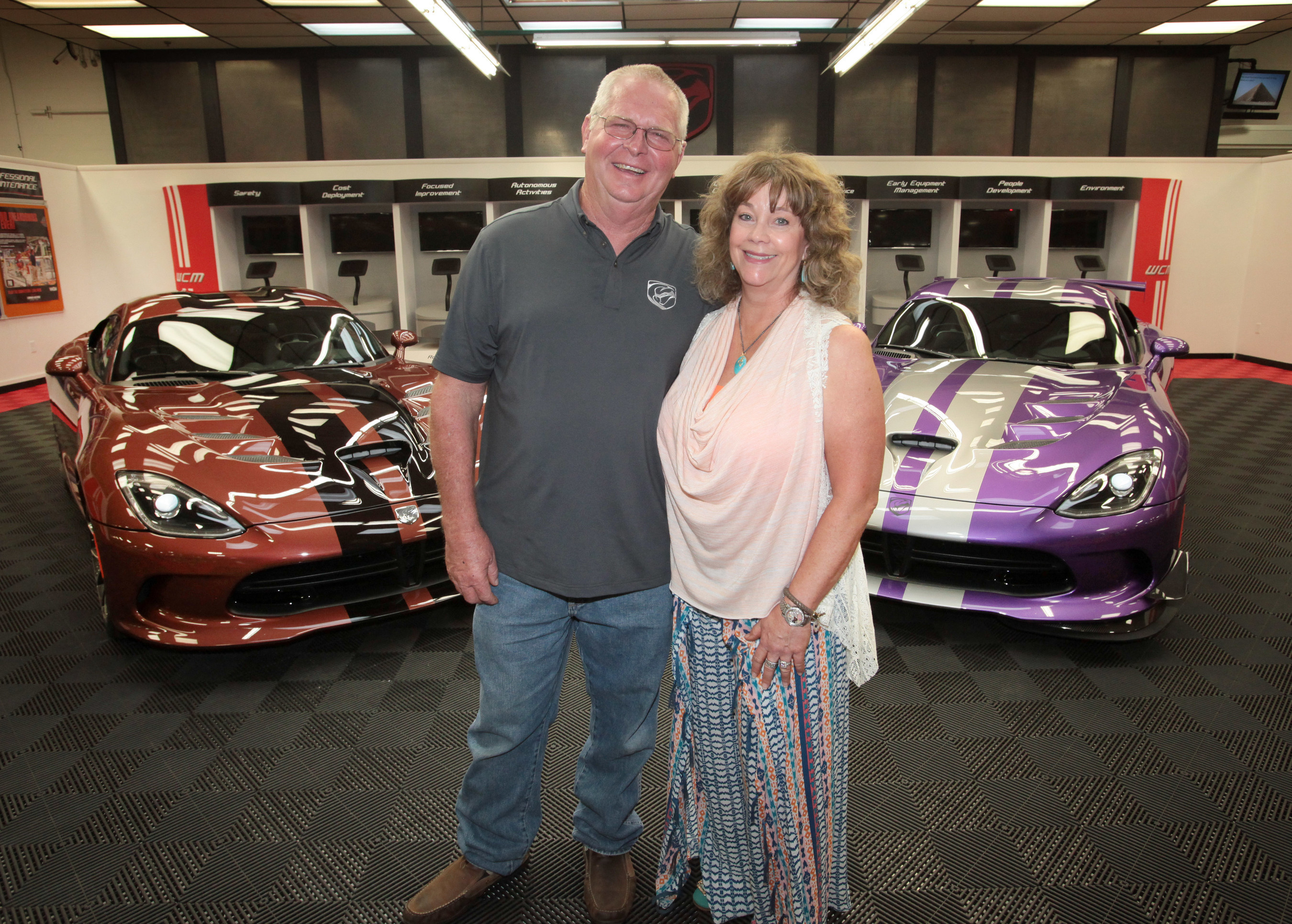 """Dodge Viper owners Wayne and D'Ann Rauh elevate Viper Nation enthusiasm to a whole new level. On Friday, July 24, the couple visits the Conner Avenue Assembly Plant in Detroit to receive keys to not one, but two new customized """"1 of 1"""" Dodge Viper GTC models, making them proud owners of a total of 79 Dodge Vipers. Through the new Viper """"1 of 1"""" customization program, owners can create their very own one-of-a-kind Snake. No two customers can order the same configuration, including color, in the same model..."""