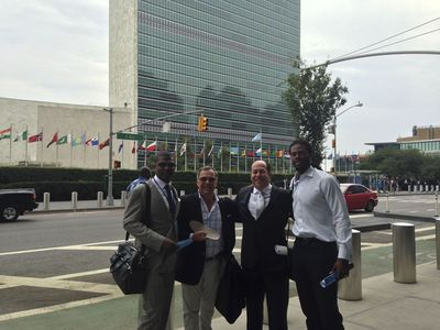From L to R: TBG CEO Jack Brewer, GTX Corp. CEO Patrick Bertagna, DirectView CEO Roger Ralston and Super Bowl Champion/Former Pro Bowl NFL WR Sidney Rice in front of United Nations following a productive day of meetings
