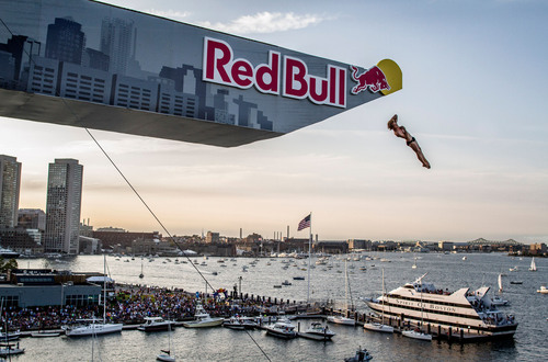 Red Bull Cliff Diving World Series Boston winner Gary Hunt twists to victory amongst the Boston Harbor sunset ...