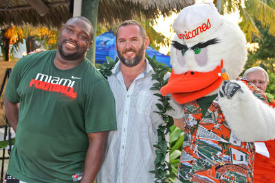 University of Miami Sports Hall of Fame President K.C. Jones (center) enjoys last year's Celebrity Dolphin Fishing Tournament with NFL Hall of Famer Warren Sapp and Miami Hurricanes Mascot Sebastian the Ibis.  (PRNewsFoto/University of Miami Sports Hall of Fame)