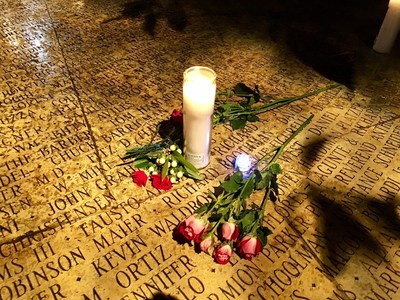 Candles and flowers are laid in the Circle of Friends at the National AIDS Memorial in San Francisco in honor of lost friends and loved ones during World AIDS Day ceremonies. Photo Source: National AIDS Memorial Grove