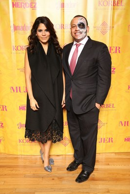 """Chicago City Treasurer Kurt Summers (right) with Cristy Marrero, Group Content Chief of Meredith Hispanic Media and Editor-in-Chief of """"Siempre Mujer"""" at the National Museum of Mexican Art's """"Love Never Dies"""" Day of the Dead ball."""