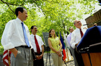 Michael Bloomberg, New York City Mayor, right, speaks while Randall Stephenson, chief executive officer of AT&T, far left, City Councilman Fernando Cabrera, second from left, City Councilwoman Melissa Mark Viverito, center, NY State Assemblyman Robert Rodriguez, listens during AT&T's free WiFi in the parks program in New York, U.S., on Thursday, June 9, 2011.  (PRNewsFoto/The City Of New York Office of the Mayor, Jin Lee)