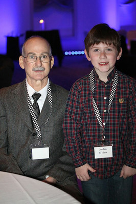 Patrick O'Hara, wearing his Freedom portable driver that powered his SynCardia Total Artificial Heart, and his youngest son, Jordan, attend a Methodist Health Foundation banquet. O'Hara, the first Indianan to receive the SynCardia Heart, was a guest of honor. (PRNewsFoto/SynCardia Systems, Inc.)