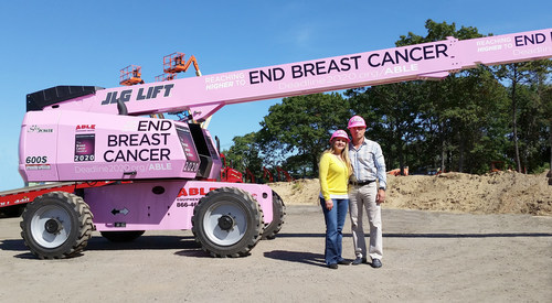Pictured left to right: ABLE Equipment Rental's co-owners Eliza and Steven Laganas.   Partnership Between ABLE Equipment Rental and The National Breast Cancer Coalition's, Breast Cancer Deadline 2020(R) Raises Awareness With The Use Of A 60 foot Reaching Higher To End Breast Cancer Pink Construction Boom.   A percentage of revenue generated from the use of the boom will be donated to the National Breast Cancer Coalition's (NBCC) Breast Cancer Deadline 2020(R) (PRNewsFoto/ABLE Equipment Rental)