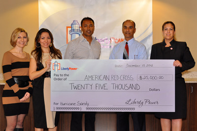 Liberty Power presented the American Red Cross South Florida Region with a check for $25,000 in support of the victims of Hurricane Sandy. The check presentation took place at the electric supplier's headquarters, located in Fort Lauderdale, FL on December 13. From right to left: From the American Red Cross South Florida Region, Tzaicel Hernandez, Major Gifts Officer and Michael Jalali, Chief Development Officer; from Liberty Power, Rana Ghosh, Chief Marketing Officer; Donna Sylvester, Marketing Manager, Campaigns; and Lindsay Goldberg, Associate Marketing Manager, Communications.  (PRNewsFoto/Liberty Power)