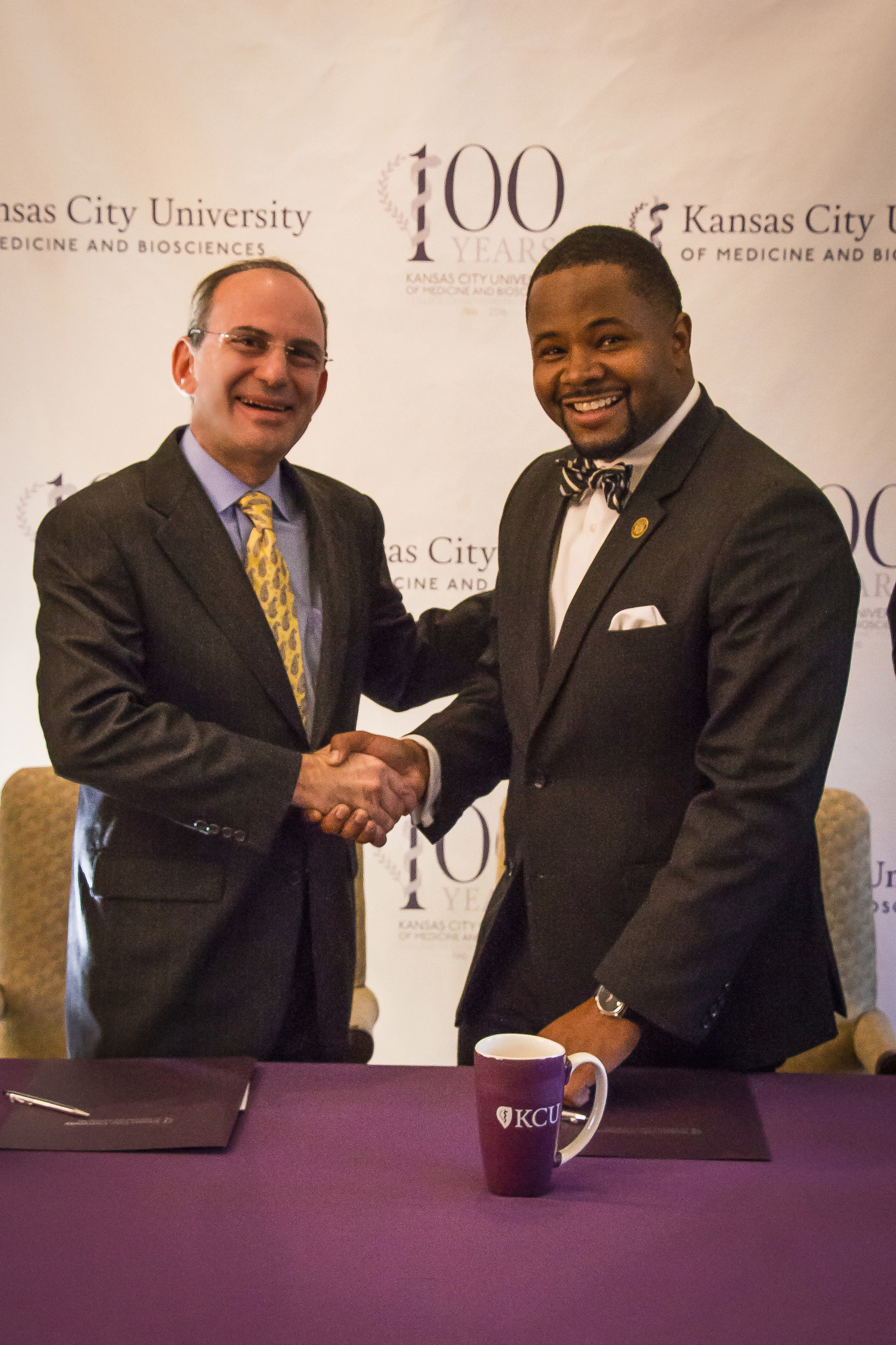 Marc B. Hahn, DO, president and chief executive officer of KCU and Dwaun J. Warmack, PhD, president of Harris-Stowe State University shake hands following the signing ceremony.