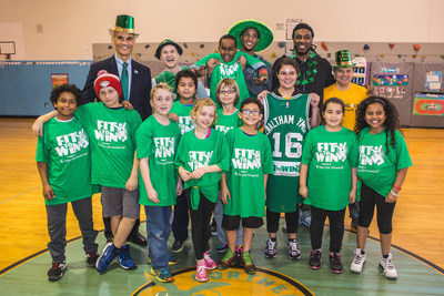 Sun Life Fit to Win winners from Stanley Elementary School in Waltham, with YMCA of Greater Boston CEO James Morton (from left), Celtics mascot Lucky the Leprechaun, Celtics forwards Evan Turner and Jae Crowder, Sun Life VP of Marketing Ed Milano
