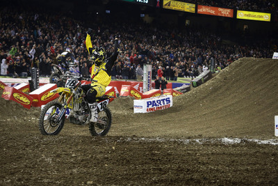 Rockstar Energy Racing's Davi Millsaps crosses the finish line on his 2013 Suzuki RM-Z450 for the team's first 450SX class win this past weekend at the opening round of the Monster Energy AMA Supercross season in Anaheim, California. American Suzuki congratulates Millsaps and the Rockstar Energy Racing team.  (PRNewsFoto/American Suzuki Motor Corporation)