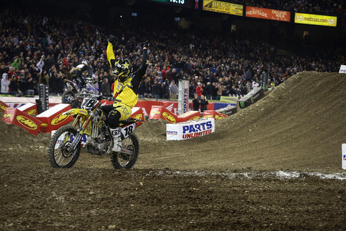 Rockstar Energy Racing's Davi Millsaps crosses the finish line on his 2013 Suzuki RM-Z450 for the ...