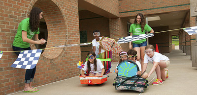 Camp Invention kids experience the Illuminate program and take part in the KartWheel module.