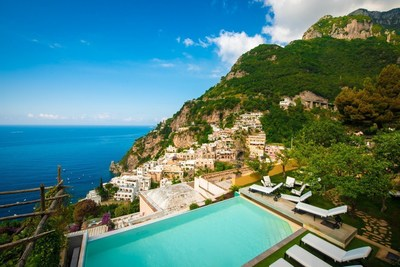 Amalfi Coast vacation villa from Carrington Italia's current portfolio of properties, featuring a private garden, pool and view of the cascading houses of Positano