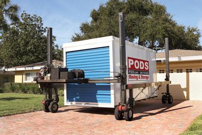 PODS(R) containers are moved via patented Podzilla(R) detachable lift system.  (PRNewsFoto/PODS Enterprises, Inc.)