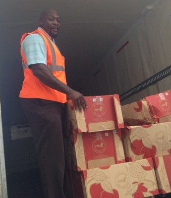 Jammie Bolton Unloading Apples He Donated At Food Bank In Chicago