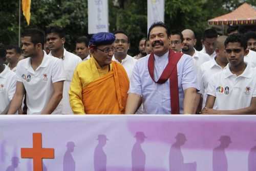 The Sri Lankan President Mahinda Rajapaksha and the Gyalwang Drukpa lead the Peace Pad Yatra as it starts off from Kataragama in Sri Lanka