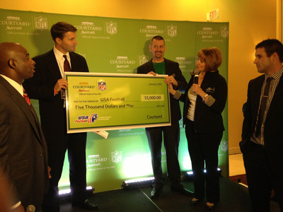 Courtyard by Marriott Donates to USA Football New Orleans League During Super Bowl XLVII.  (PRNewsFoto/Marriott International, Inc.)