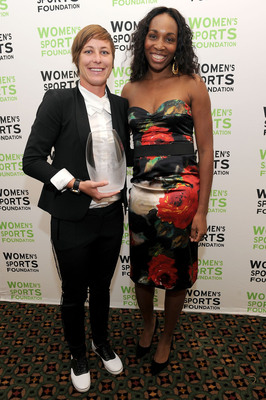 Abby Wambach accepts the Women's Sports Foundation's Sportswoman of the Year - Team Award from Venus Williams at the 32nd Annual Salute to Women in Sports October 19th at Cipriani Wall Street in New York City.  (PRNewsFoto/Women's Sports Foundation, Jason Kempin)