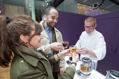 Heston Blumenthal treats a young couple out shopping to a free cup of perfectly brewed tea made using the Sage Tea Maker (PRNewsFoto/Sage Appliances)