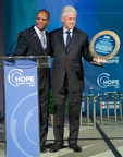 "Operation HOPE president and founder John Hope Bryant presents the ""Civil Rights to Silver Rights Award"" to President Bill Clinton."