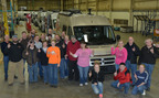 Winnebago employees celebrate the first Travato to be completed in the new Lake Mills Assembly Facility.  (PRNewsFoto/Winnebago Industries, Inc.)