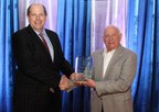 Southern Company's Chief Environmental Officer Dr. Larry S. Monroe (L) accepts Chairman's Award from Southeastern Electric Exchange Executive Director Jim Collins. (PRNewsFoto/Southern Company)